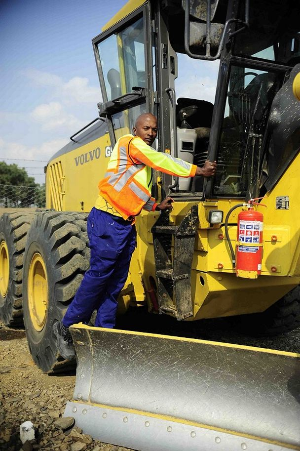 Former Sundowns star Papi Mbele now works at a tar road construction site