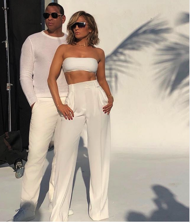 Standing All White Photo Of JLO And Alex